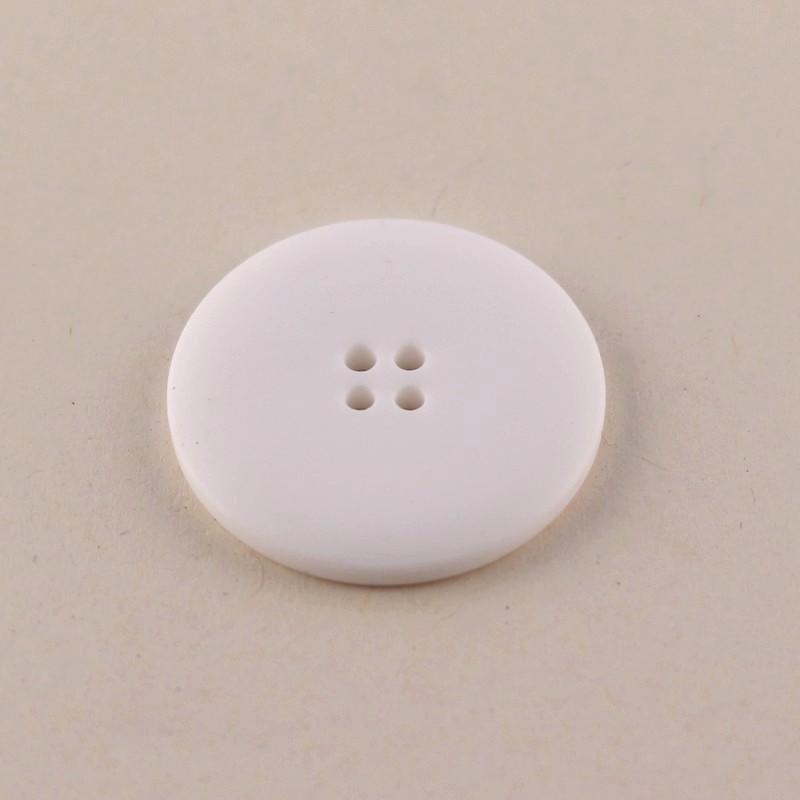 White haberdashery button