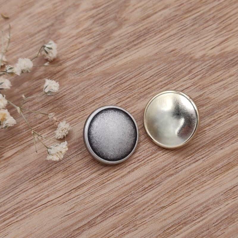 Bouton metal dore et argente
